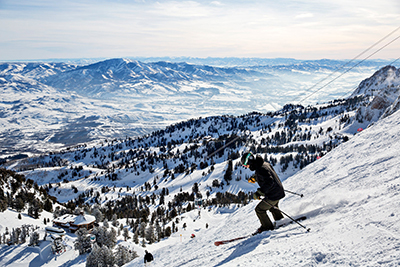 Person skiing down a snowy mountain